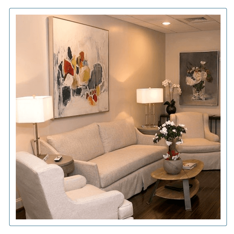 waiting room for Koch Aesthetic Dentistry with couches and artwork